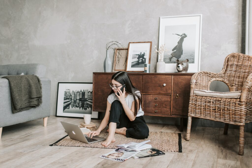 Focused Young Woman With Laptop And Smartphone In Modern 4050321