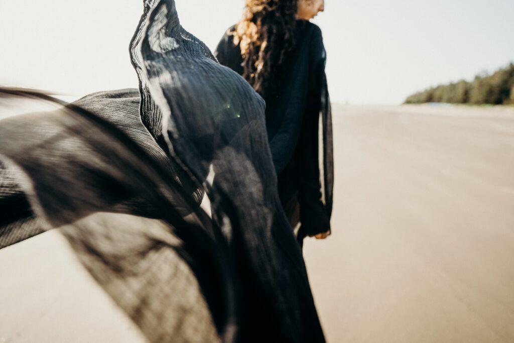 Man In Black Suit Standing On Desert 4431039