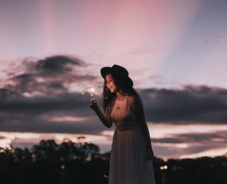 Woman In White Dress Holding Camera During Night Time 4626627